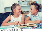 Купить «Brother with sister are doing homework», фото № 28498186, снято 23 мая 2019 г. (c) Яков Филимонов / Фотобанк Лори