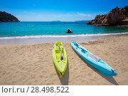 Ibiza cala Sant Vicent beach with Kayaks san Juan at Balearic Islands of spain. Стоковое фото, фотограф Tono Balaguer / Ingram Publishing / Фотобанк Лори