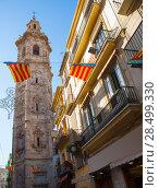 Купить «Valencia Santa Catalina church tower view from Calle la Paz in spain», фото № 28499330, снято 19 апреля 2019 г. (c) Ingram Publishing / Фотобанк Лори