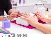 Купить «Nails saloon woman nail polish remove with tissue for new manicure», фото № 28499366, снято 18 ноября 2013 г. (c) Ingram Publishing / Фотобанк Лори