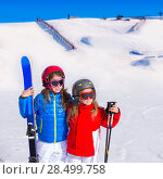 Купить «Kid girls sister in winter snow with ski equipment helmet goggles poles», фото № 28499758, снято 26 января 2014 г. (c) Ingram Publishing / Фотобанк Лори