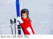 Купить «Kid girl winter snow with ski equipment helmet goggles poles», фото № 28499782, снято 26 января 2014 г. (c) Ingram Publishing / Фотобанк Лори