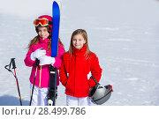 Купить «Kid girls sister in winter snow with ski equipment helmet goggles poles», фото № 28499786, снято 26 января 2014 г. (c) Ingram Publishing / Фотобанк Лори
