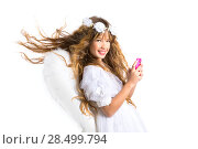 Купить «Angel blond girl with mobile smartphone and feather wings on white byod to heaven», фото № 28499794, снято 9 февраля 2014 г. (c) Ingram Publishing / Фотобанк Лори