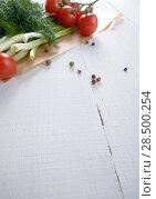Купить «Fresh organic vegetable set of tomatoes dill and onion on white kitchen table», фото № 28500254, снято 24 апреля 2013 г. (c) Ingram Publishing / Фотобанк Лори