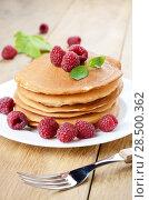 Купить «Ready to eat pancakes with raspberry on the white plate», фото № 28500362, снято 16 августа 2013 г. (c) Ingram Publishing / Фотобанк Лори