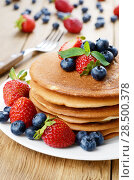 Купить «Stack of pancakes with strawberries raspberries and blueberries on white plate», фото № 28500378, снято 16 августа 2013 г. (c) Ingram Publishing / Фотобанк Лори