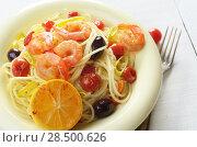 Купить «Seafood spaghetti pasta dish with shrimps cherry tomatoes and olives», фото № 28500626, снято 20 января 2014 г. (c) Ingram Publishing / Фотобанк Лори