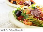 Купить «Seafood spaghetti pasta dish with octopus, shrimps, cherry tomatoes and olives», фото № 28500638, снято 20 января 2014 г. (c) Ingram Publishing / Фотобанк Лори