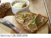 Liver paste simple sandwich with arugula on the kitchen table. Стоковое фото, агентство Ingram Publishing / Фотобанк Лори