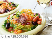 Купить «Seafood spaghetti pasta dish with octopus, shrimps, cherry tomatoes and olives», фото № 28500686, снято 21 октября 2019 г. (c) Ingram Publishing / Фотобанк Лори