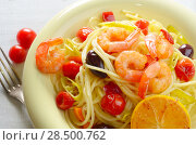 Купить «Seafood spaghetti pasta dish with shrimps cherry tomatoes and olives», фото № 28500762, снято 18 октября 2018 г. (c) Ingram Publishing / Фотобанк Лори