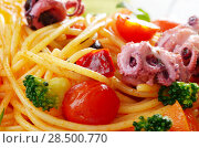 Купить «Seafood spaghetti marinara pasta with octopus, shrimps, cherry tomatoes and olives», фото № 28500770, снято 18 октября 2018 г. (c) Ingram Publishing / Фотобанк Лори