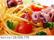 Купить «Seafood spaghetti marinara pasta with octopus, shrimps, cherry tomatoes and olives», фото № 28500770, снято 19 января 2019 г. (c) Ingram Publishing / Фотобанк Лори