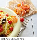 Купить «Seafood spaghetti pasta dish with shrimps cherry tomatoes and olives», фото № 28500786, снято 23 июля 2018 г. (c) Ingram Publishing / Фотобанк Лори