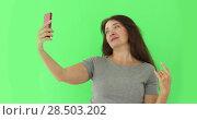 Купить «Senior woman taking selfie cellphone isolated», видеоролик № 28503202, снято 1 июня 2018 г. (c) Ekaterina Demidova / Фотобанк Лори