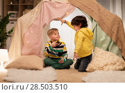 Купить «happy boys with torch light in kids tent at home», фото № 28503510, снято 18 февраля 2018 г. (c) Syda Productions / Фотобанк Лори