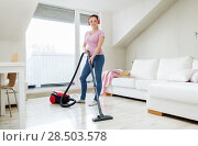 Купить «woman with vacuum cleaner and headphones at home», фото № 28503578, снято 29 апреля 2018 г. (c) Syda Productions / Фотобанк Лори