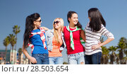 Купить «teenage girls or young women over venice beach», фото № 28503654, снято 31 августа 2013 г. (c) Syda Productions / Фотобанк Лори