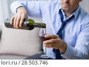 Купить «alcoholic pouring red wine to glass at home», фото № 28503746, снято 24 ноября 2017 г. (c) Syda Productions / Фотобанк Лори