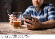 Купить «man with cellphone drinking alcohol and smoking», фото № 28503754, снято 24 ноября 2017 г. (c) Syda Productions / Фотобанк Лори