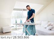 Купить «man ironing shirt by iron at home», фото № 28503866, снято 10 мая 2018 г. (c) Syda Productions / Фотобанк Лори
