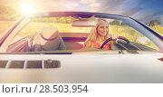 Купить «happy young woman driving convertible car», фото № 28503954, снято 17 августа 2017 г. (c) Syda Productions / Фотобанк Лори