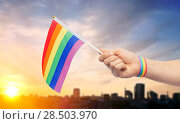 Купить «hand with gay pride rainbow flag and wristband», фото № 28503970, снято 2 ноября 2017 г. (c) Syda Productions / Фотобанк Лори