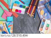 Купить «School stationery on background blackboard», фото № 28510494, снято 25 декабря 2017 г. (c) Майя Крученкова / Фотобанк Лори
