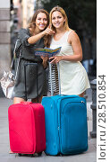 Купить «Two women with baggage checking route outdoors», фото № 28510854, снято 15 августа 2018 г. (c) Яков Филимонов / Фотобанк Лори