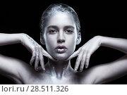 Купить «Beauty portrait of young gorgeous woman. Female with hand near face on black background», фото № 28511326, снято 17 февраля 2018 г. (c) Serg Zastavkin / Фотобанк Лори