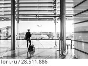 Купить «Young woman waiting at airport, looking through the gate window.», фото № 28511886, снято 21 августа 2019 г. (c) Matej Kastelic / Фотобанк Лори