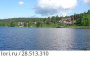 Купить «Солнечный день на озере  Ванаявеси. Окрестности города Хамеенлинна, Финляндия», видеоролик № 28513310, снято 10 июня 2017 г. (c) Виктор Карасев / Фотобанк Лори