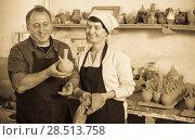 Купить «Couple among the pottery», фото № 28513758, снято 12 октября 2016 г. (c) Яков Филимонов / Фотобанк Лори