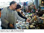 Купить «Man and his wife are visiting market of old things», фото № 28514018, снято 23 октября 2017 г. (c) Яков Филимонов / Фотобанк Лори
