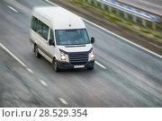 Купить «Bus goes on highway», фото № 28529354, снято 7 июня 2015 г. (c) Юрий Бизгаймер / Фотобанк Лори