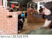 Купить «adult players are targeting in enemy behind barricades», фото № 28529974, снято 10 июля 2017 г. (c) Яков Филимонов / Фотобанк Лори