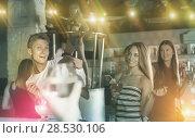 Купить «Group of ordinary people clubbing in the club», фото № 28530106, снято 28 августа 2017 г. (c) Яков Филимонов / Фотобанк Лори