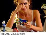 Купить «Wedding memories. Broken heart woman. Family break up.», фото № 28530650, снято 21 июля 2018 г. (c) Gennadiy Poznyakov / Фотобанк Лори