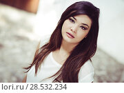 Купить «Portrait of beautiful japanese woman in urban background», фото № 28532234, снято 5 сентября 2013 г. (c) Ingram Publishing / Фотобанк Лори
