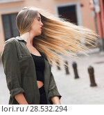 Portrait of blonde girl moving her amazing long hair. Стоковое фото, фотограф Javier Sánchez Mingorance / Ingram Publishing / Фотобанк Лори