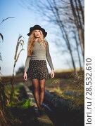 Купить «Beautiful young blonde woman, model of fashion, in rural background. Girl wearing sweater, skirt and hat.», фото № 28532610, снято 17 ноября 2015 г. (c) Ingram Publishing / Фотобанк Лори