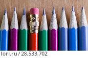 Купить «Black lead pencils lie in a row, one pencil has an eraser on the end», фото № 28533702, снято 5 марта 2016 г. (c) Куликов Константин / Фотобанк Лори