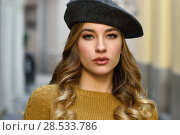 Купить «Blonde russian woman in urban background. Beautiful young girl wearing beret, black leather jacket and mini skirt standing in the street. Pretty female with long wavy hair hairstyle and blue eyes.», фото № 28533786, снято 24 января 2017 г. (c) Ingram Publishing / Фотобанк Лори