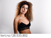Купить «Young girl wearing black bra. Studio shot.», фото № 28533802, снято 21 января 2018 г. (c) Ingram Publishing / Фотобанк Лори
