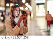 Купить «Woman taking photograph with smartphone at night in the street», фото № 28534258, снято 20 сентября 2017 г. (c) Ingram Publishing / Фотобанк Лори