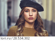 Купить «Blonde russian woman in urban background. Beautiful young girl wearing beret, black leather jacket and mini skirt standing in the street. Pretty female with long wavy hair hairstyle and blue eyes.», фото № 28534302, снято 24 января 2017 г. (c) Ingram Publishing / Фотобанк Лори