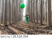 Купить «Beautiful blonde girl, dressed in green, laughing in the forest», фото № 28534394, снято 4 декабря 2011 г. (c) Ingram Publishing / Фотобанк Лори