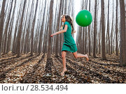 Купить «Beautiful blonde girl, dressed in green, jumping into the woods with a balloon in Fuente Vaqueros, Granada, Spain», фото № 28534494, снято 4 декабря 2011 г. (c) Ingram Publishing / Фотобанк Лори