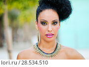 Купить «Portrait of a young black woman, model of fashion, with fantasy make up made by a professional beautician», фото № 28534510, снято 16 сентября 2012 г. (c) Ingram Publishing / Фотобанк Лори